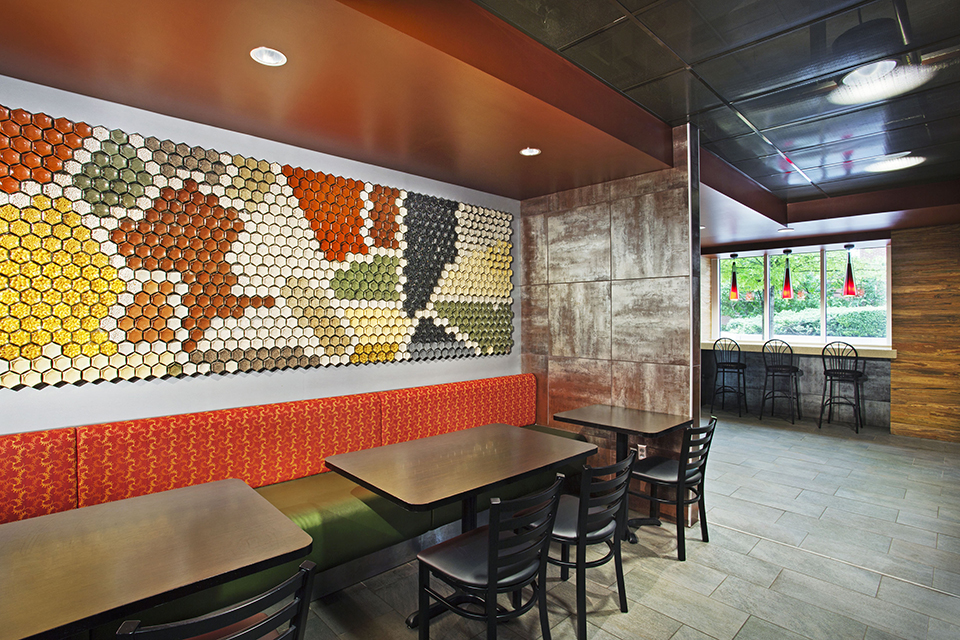 UT Knoxville Spice Wall Rack Restaurant Installation Hex Jar Seating Alcove View